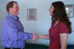 Reiki practitioner and client shake hands.